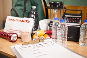 first aid kit image with supplies out on a table